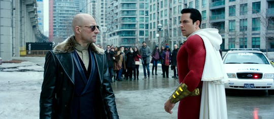 "The title teen-turned-superhero (Zachary Levi, right) learns his new powers and deals with bad guys like Dr. Sivana (Mark Strong) in ""Shazam!"""