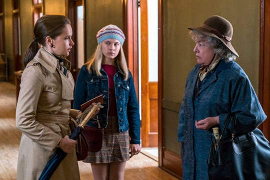 Ruth (Felicity Jones, left) and Jane (Cailee Spaeny) seek out of the help of women's rights advocate Dorothy Kenyon (Kathy Bates) in the film.