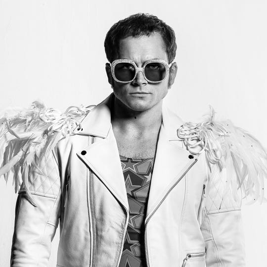 "Taron Egerton wears a variety of Elton John's flamboyant looks playing the pop legend in the musical fantasy ""Rocketman."""