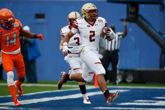 Boston College running back A.J. Dillon  scores the SERVPRO First Responder Bowl's only touchdown in the first quarter. The game was called due to lightning.