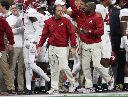 Alabama coach Nick Saban walks on the sideline during his team's game against Georgia in the College Football Playoff championship game on Jan. 8, 2018.