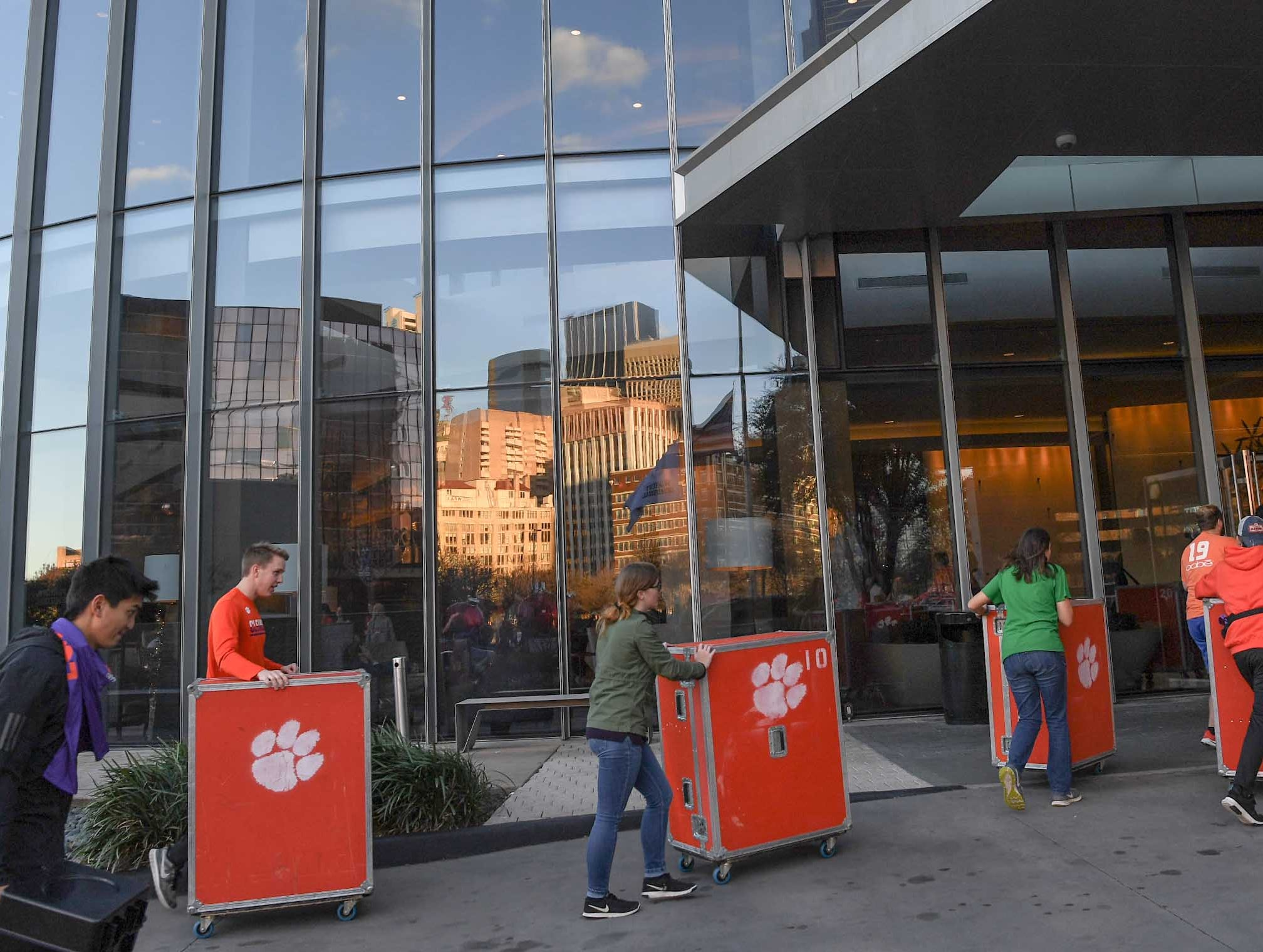 A skyline of downtown buildings reflect in the windows of the hotel after Clemson Band practice at the Omni in Dallas December 27, 2018.