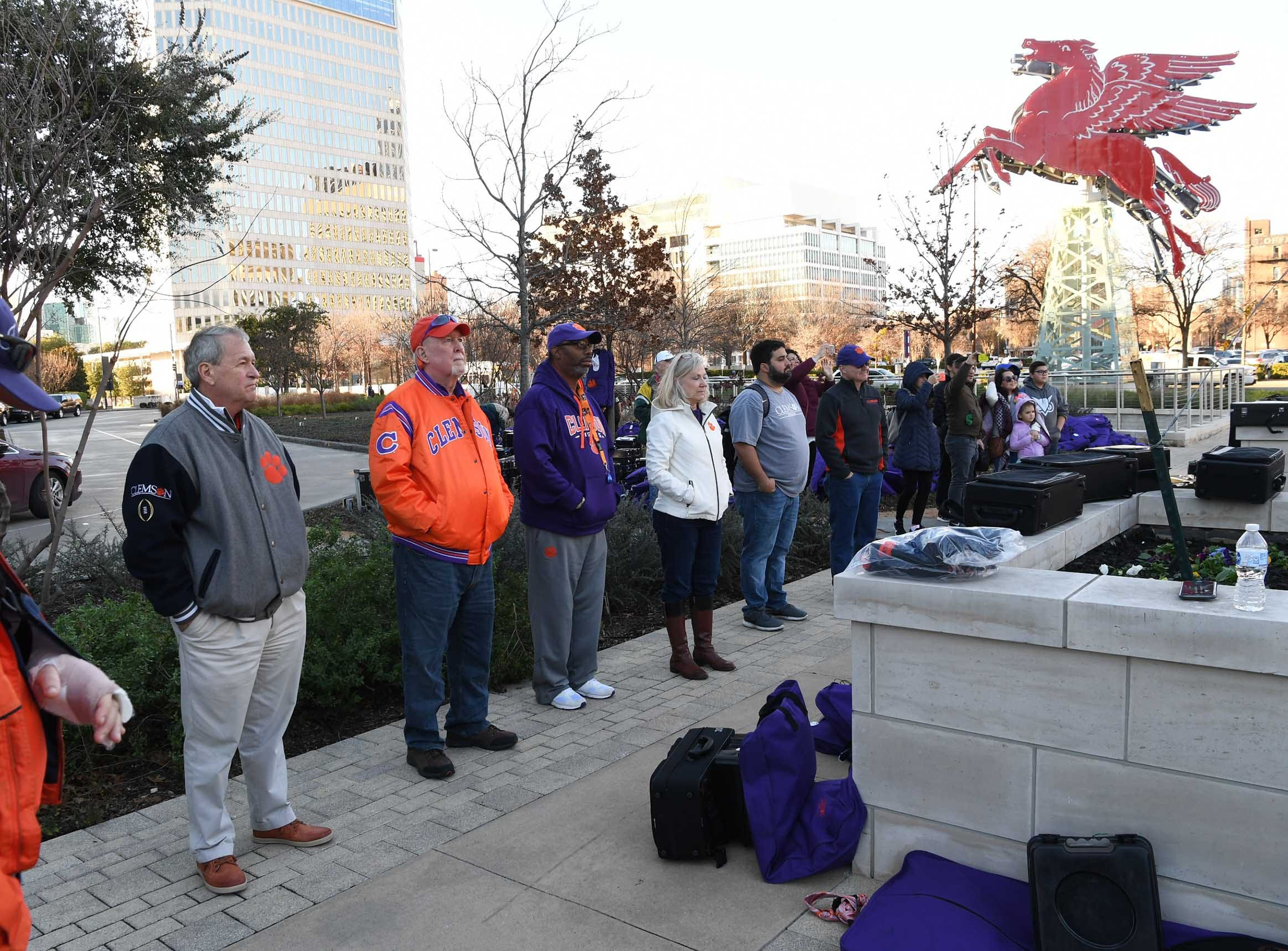 Clemson fans watch during Clemson Band practice outside the Omni in Dallas December 27, 2018.