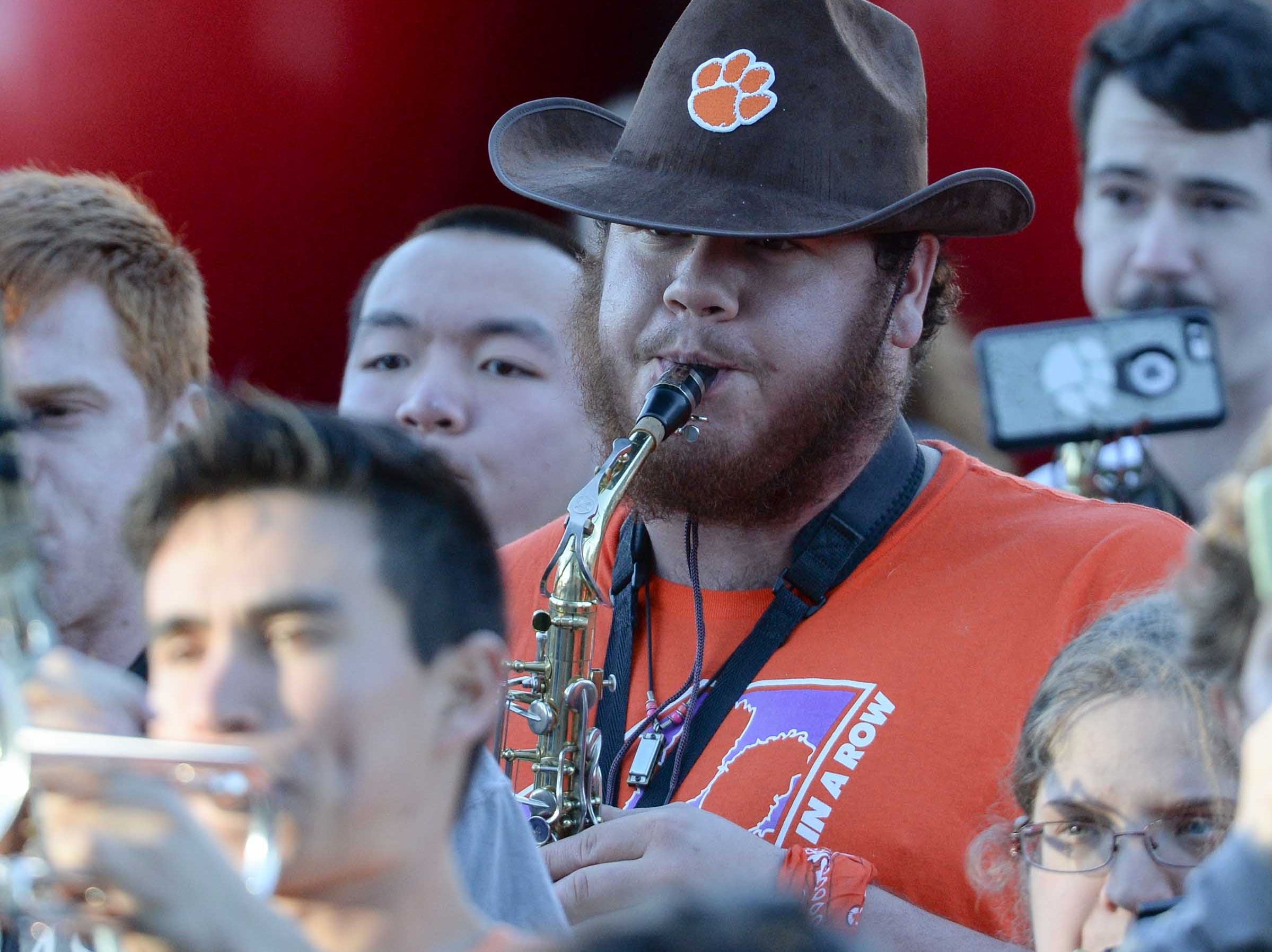 Joshua Stapleton, middle, wears a cowboy hat during Clemson Band practice outside the Omni in Dallas December 27, 2018.