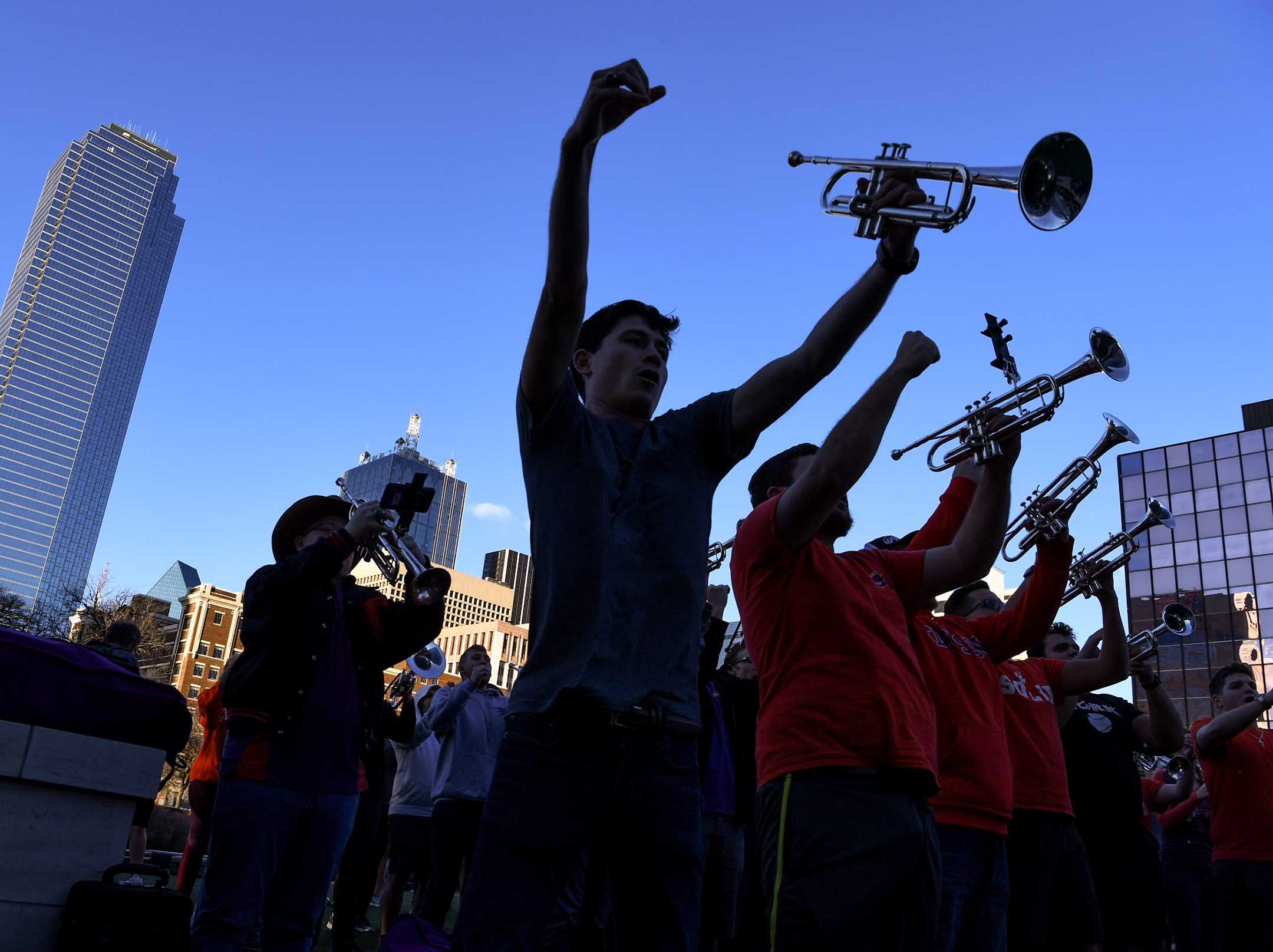 Will McAlhany, middle, pumps his fists with bandmates during Clemson Band practice outside the Omni in Dallas December 27, 2018.