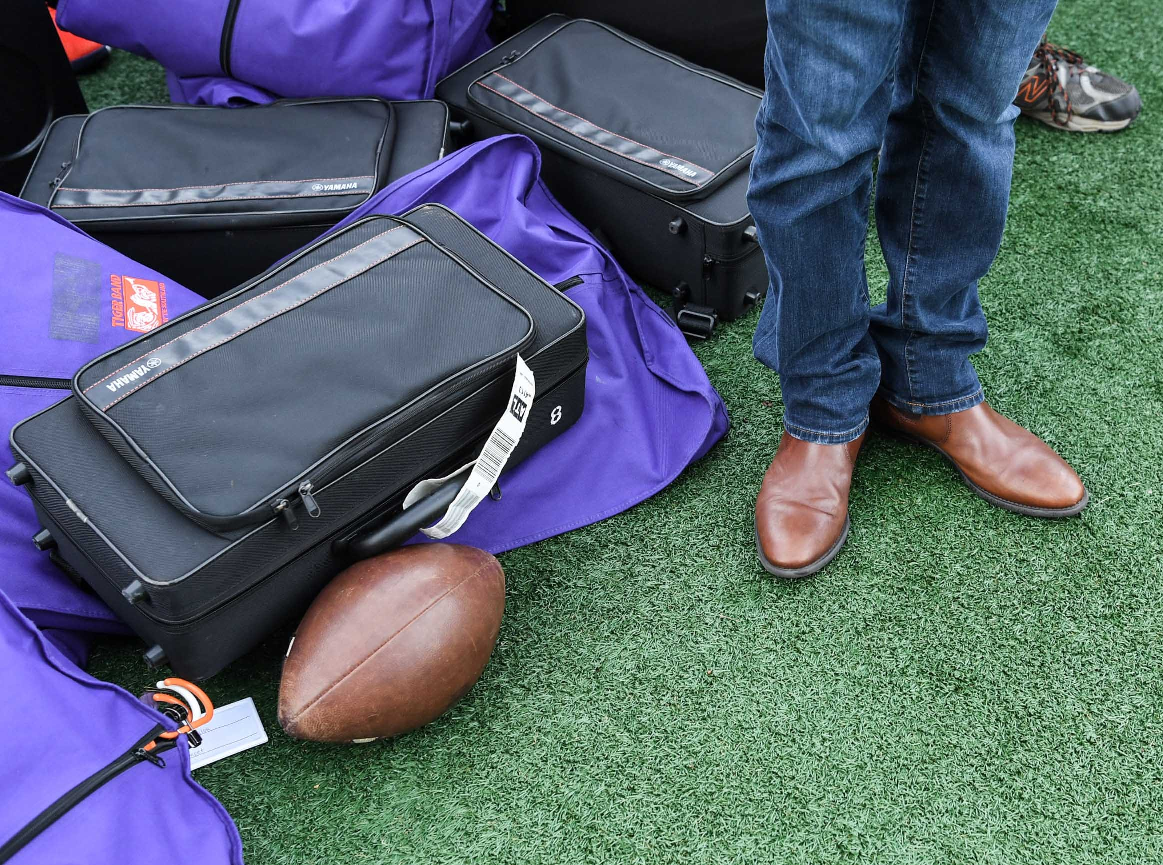 Will McAlhany plays trumpet near a football and band cases during Clemson Band practice outside the Omni in Dallas December 27, 2018.