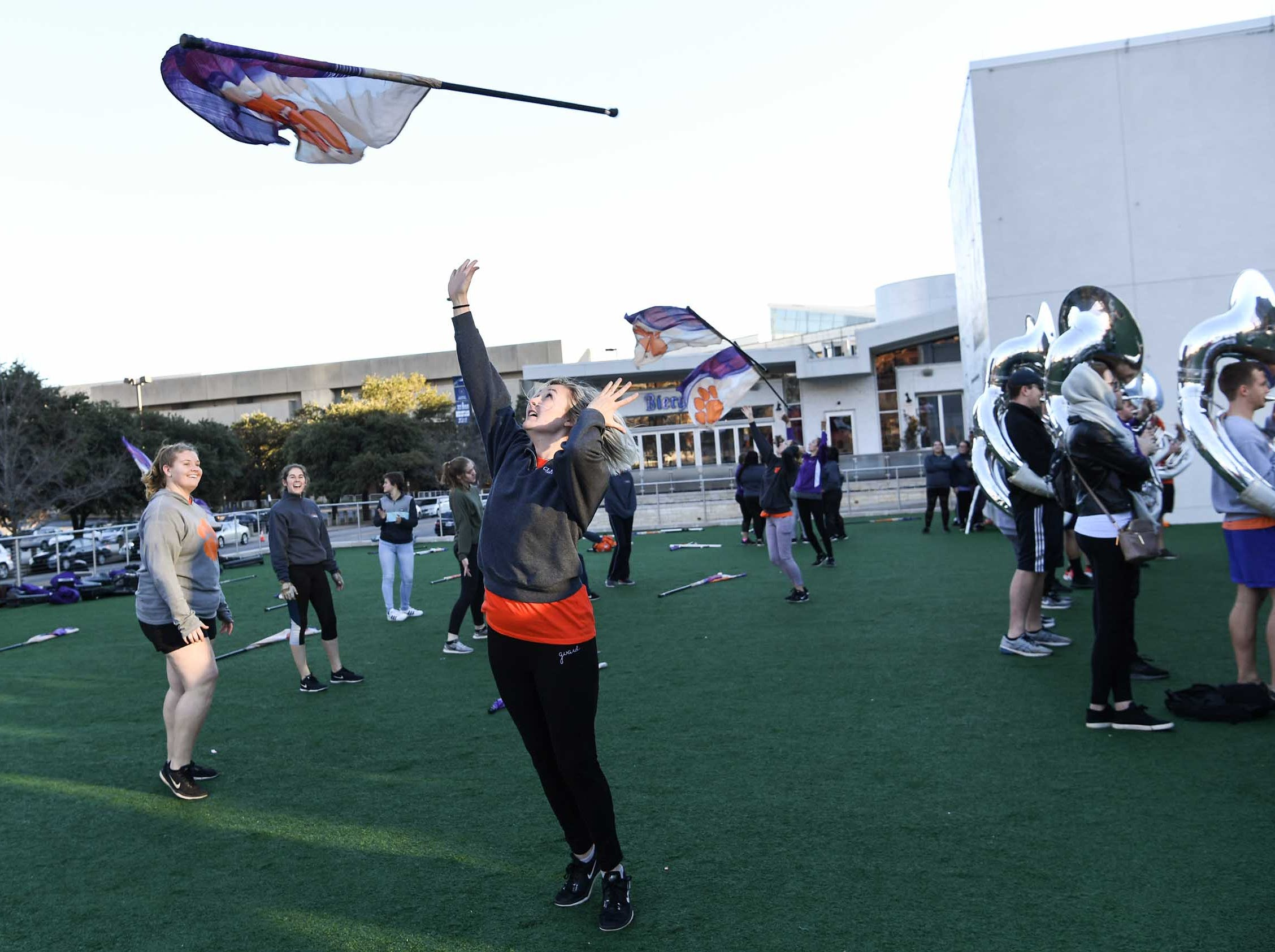 A Tiger Twirler practices while the Clemson Band plays outside the Omni in Dallas December 27, 2018.
