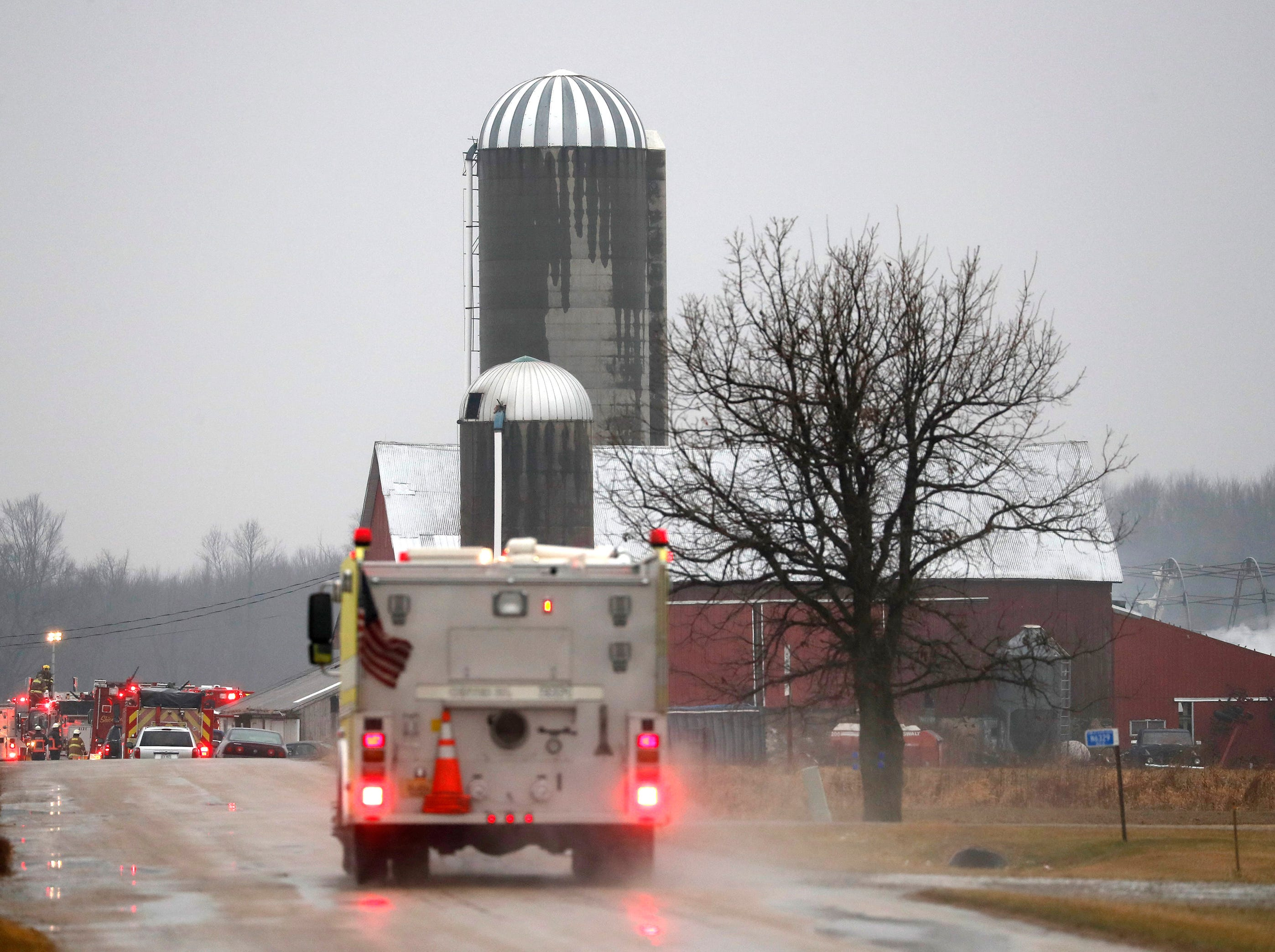 A firetruck heads to the scene of a fire on Wick Road Thursday, Dec. 27, 2018, Black Creek, Wis.