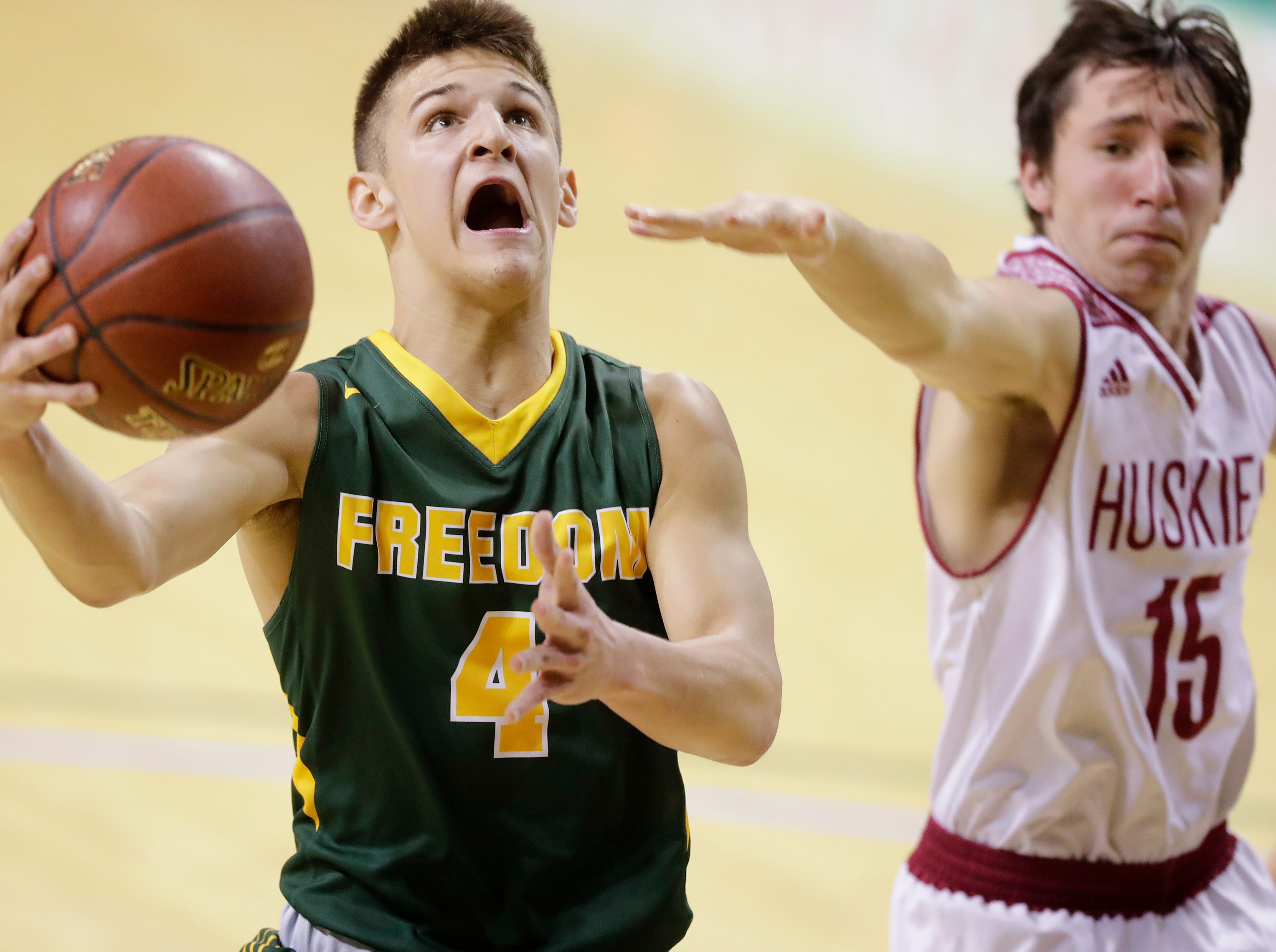 Freedom's Zachary Mashlan (4) scores against New Holstein at the Sun Drop Shootout at the Kress Center on Thursday, December 27, 2018 in Green Bay, Wis.