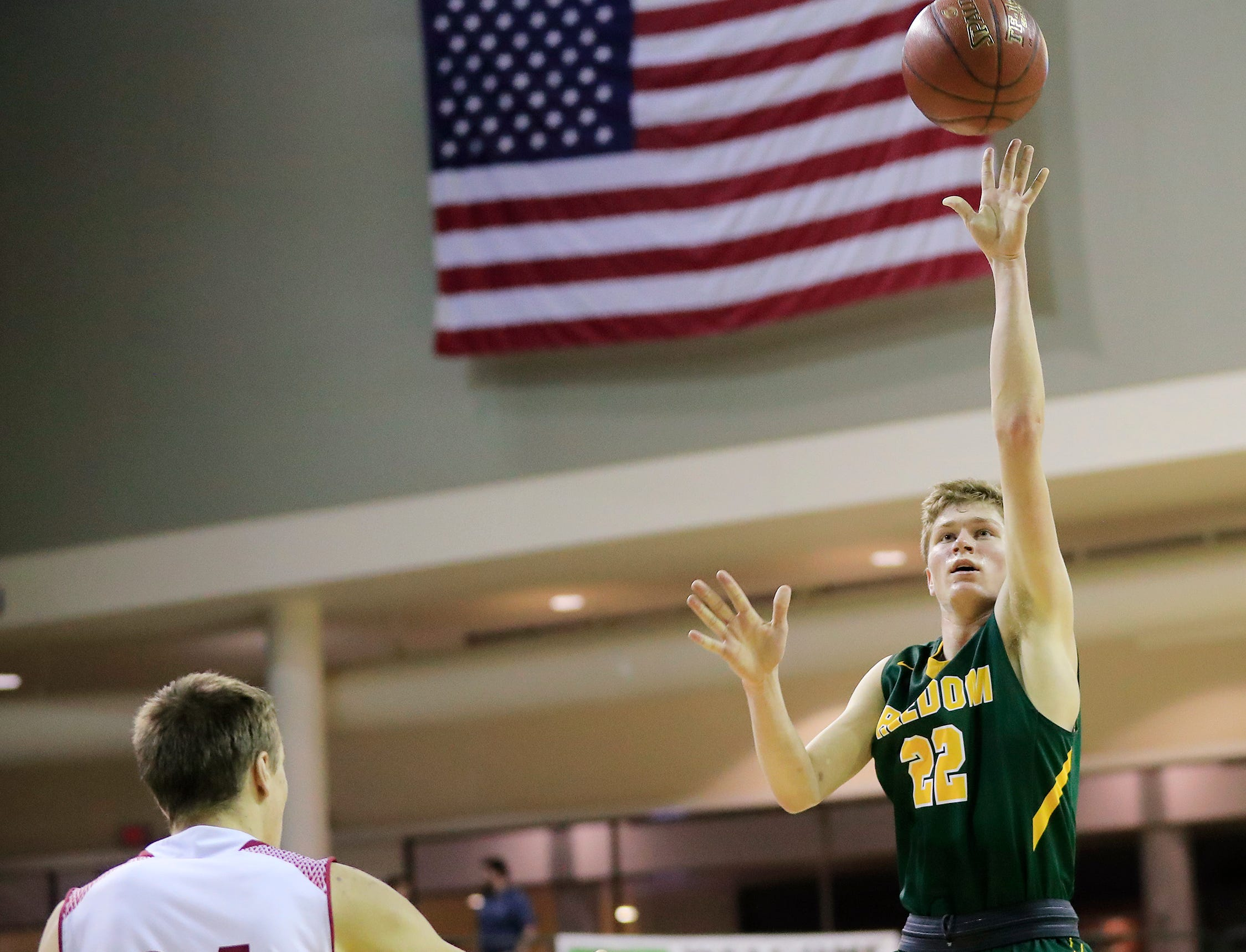 Freedom's Ty Brickner (22) shoots against New Holstein at the Sun Drop Shootout at the Kress Center on Thursday, December 27, 2018 in Green Bay, Wis.