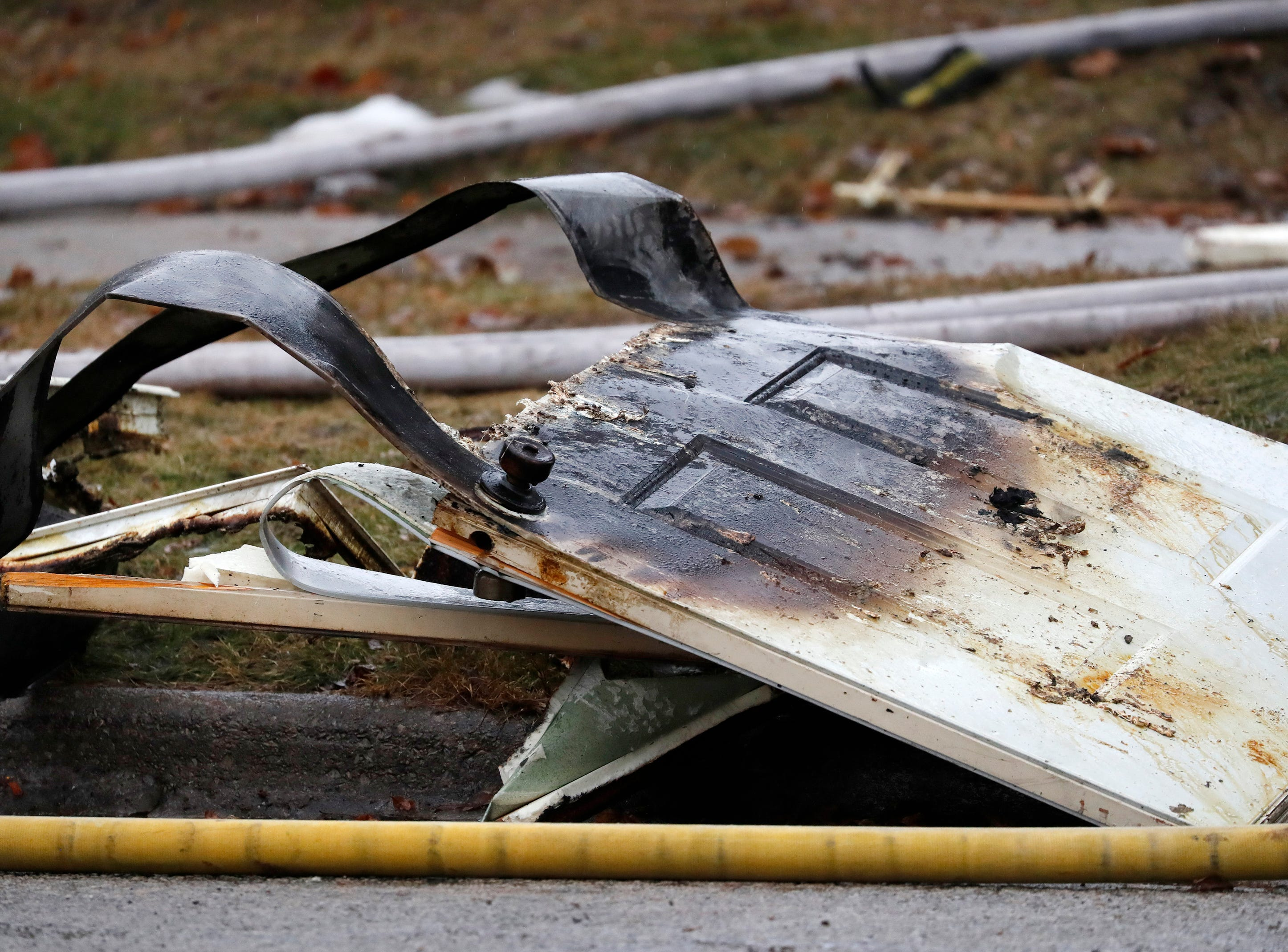 A destroyed door on the scene of a structure of a fire on West 10th Street Thursday, Dec. 27, 2018, Kaukauna, Wis.Danny Damiani/USA TODAY NETWORK-Wisconsin
