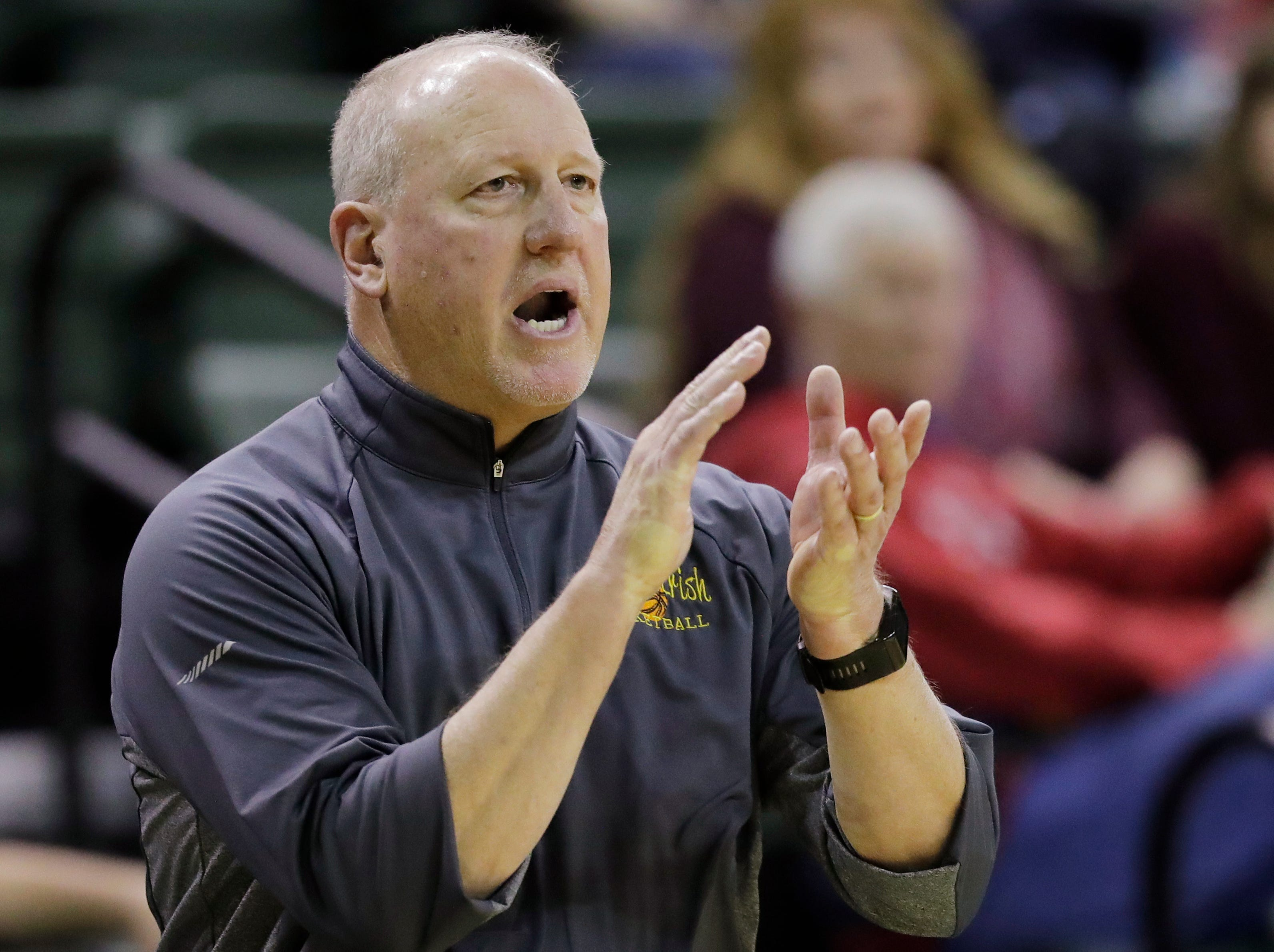 Freedom head coach John Miron applauds his players against New Holstein at the Sun Drop Shootout at the Kress Center on Thursday, December 27, 2018 in Green Bay, Wis.