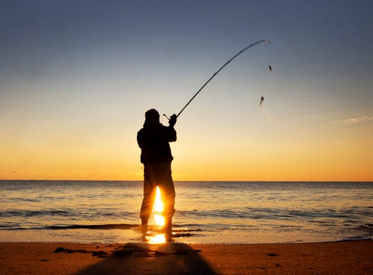 A fisherman casts his line shortly after sunrise on Long Beach Island.