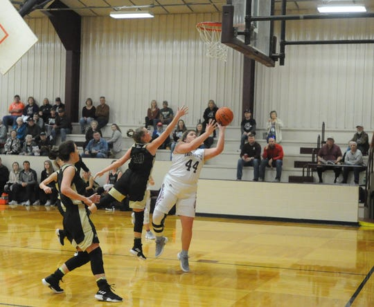 Eula senior post Abbey Matties (44) goes for a shot underneath the basket as Clyde's Brooke Widener (10) defends.