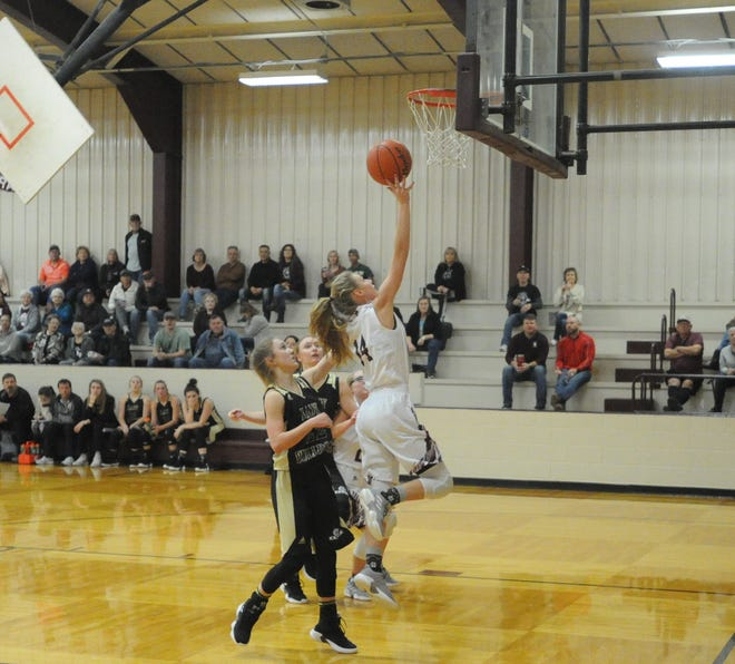 Eula senior guard Kailey Fenton (14) scores on a layup in front of Clyde's Averi Berry.