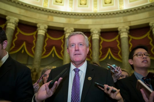Rep. Mark Meadows, R-N.C., chairman of the House Freedom Caucus, walks as he speaks with reporters as they work to pass a bill that would pay for President Donald Trump's border wall and avert a partial government shutdown, on Capitol Hill Dec. 21 in Washington. Meadows represents the 11th District. (AP Photo/Alex Brandon)