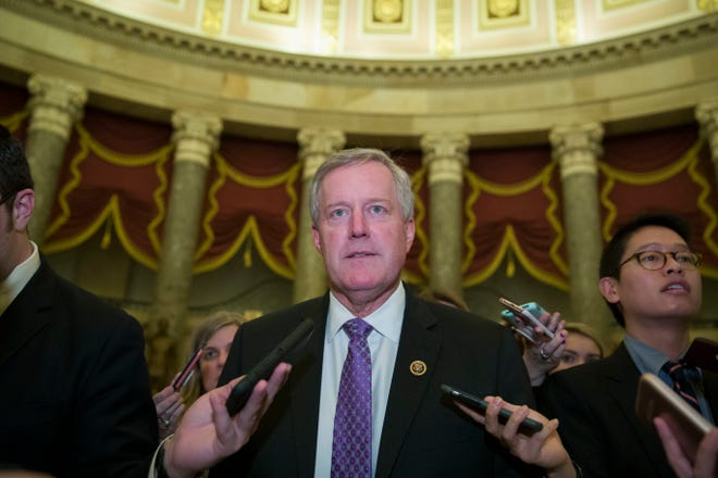 Rep. Mark Meadows, R-N.C., chairman of the House Freedom Caucus, walks as he speaks with reporters as they work to pass a bill that would pay for President Donald Trump's border wall and avert a partial government shutdown, on Capitol Hill Dec. 21in Washington. (AP Photo/Alex Brandon)