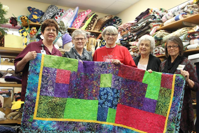 Jenny Evans, Teresa Ballard, Jeri Ellerthorpe, Shirley Paulson and Mary Smith-Stokes are just some of the Charitable Union volunteers who make items to be sold in the organization's gift shop. The funds from the gift shop help buy clothes and essential items for the needy.