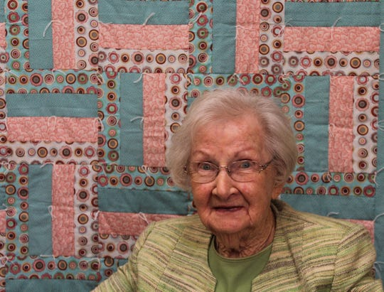 Ruth Rabbitt with one of the quilts she designed for Charitable Union.