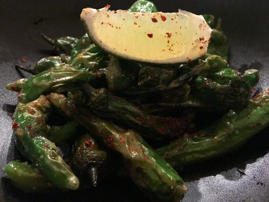 Shishito Peppers are an appetizer on Nomikui Ramen's menu.