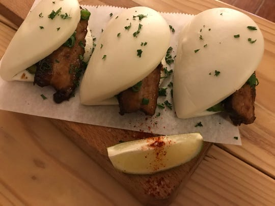 The Pork Belly Bao at Nomikui Ramen in Downtown Binghamton fis made with huisin, negi and weet pickled cucumber. It's a poular menu item.