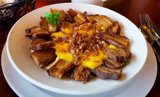 When it came to grits as an entree, David Saylor loved the Get In My Belly grits with pork belly at Darci's Bacon Blues in Cape Canaveral.
