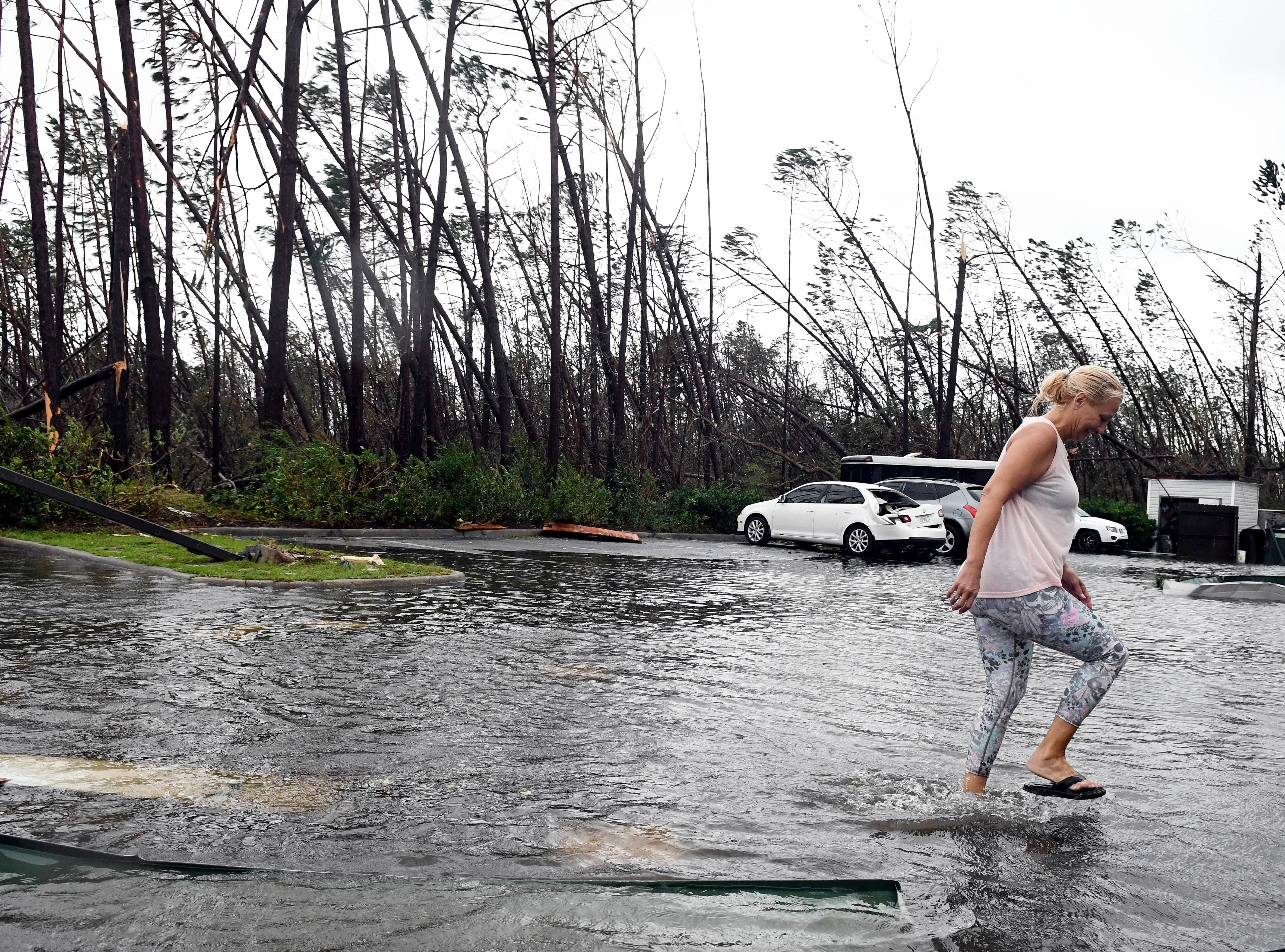 A woman walks through a flooded hotel parking lot in Panama City, FL Wednesday after Hurricane Michael. Mandatory Credit: Craig Bailey/FLORIDA TODAY via USA TODAY NETWORK