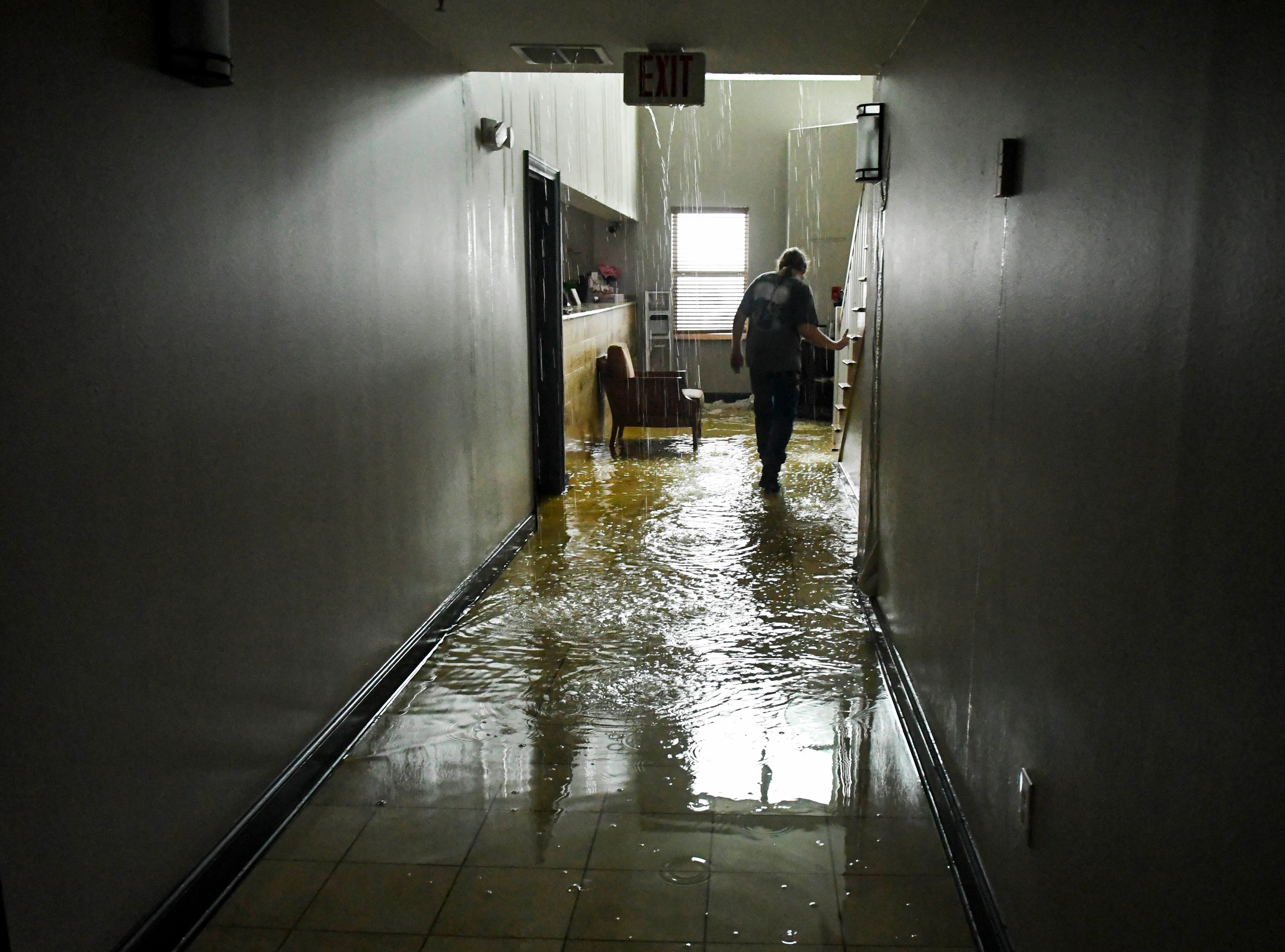 Water pours into the lobby of the Comfort Inn and Suites in Panama City Wednesday. Part of the roof was removed by Hurricane Michael  Mandatory Credit: Craig Bailey/FLORIDA TODAY via USA TODAY NETWORK