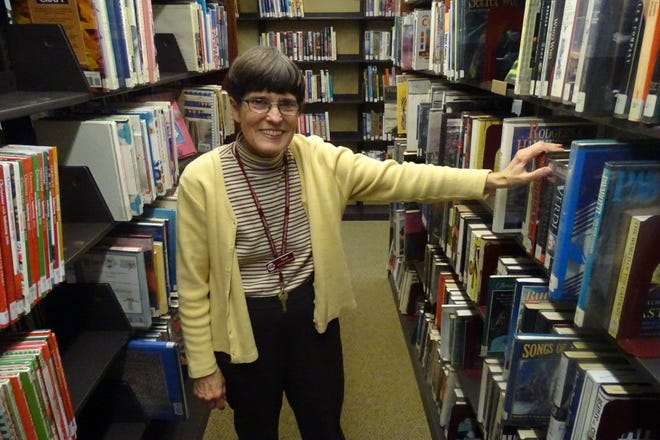Susan Keller stands among the stacks of books inside the Bucyrus Public Library.