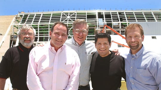 From left are Corpus Christi City Manager Skip Noe; Corpus christi IceRays owner, Doug Frank; Corpus Christi Mayor Loyd Neal;  arena manager Marc Solis;  and IceRays general manager Larry Linde. They all spoke July 8, 2004 during a press conference to announce the new contract where the IceRays will use the new arena in background.