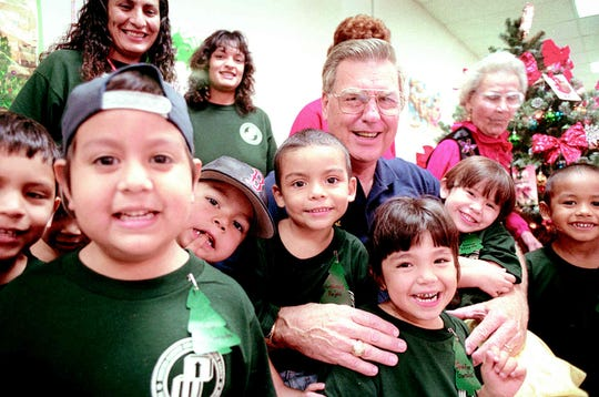 Kids with the La Armada Head Start Program pose with Mayor Loyd Neal (center, right) during a party in December 1999 where they received stockings from volunteers with the City of Corpus Christi Retired and Senior Volunteer Program.