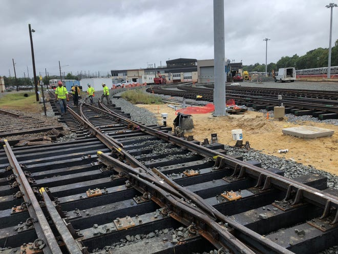Workers surveying 50-year-old rails for replacement in 2019 at the Lindenwold rail yard of the PATCO HI-Speedline