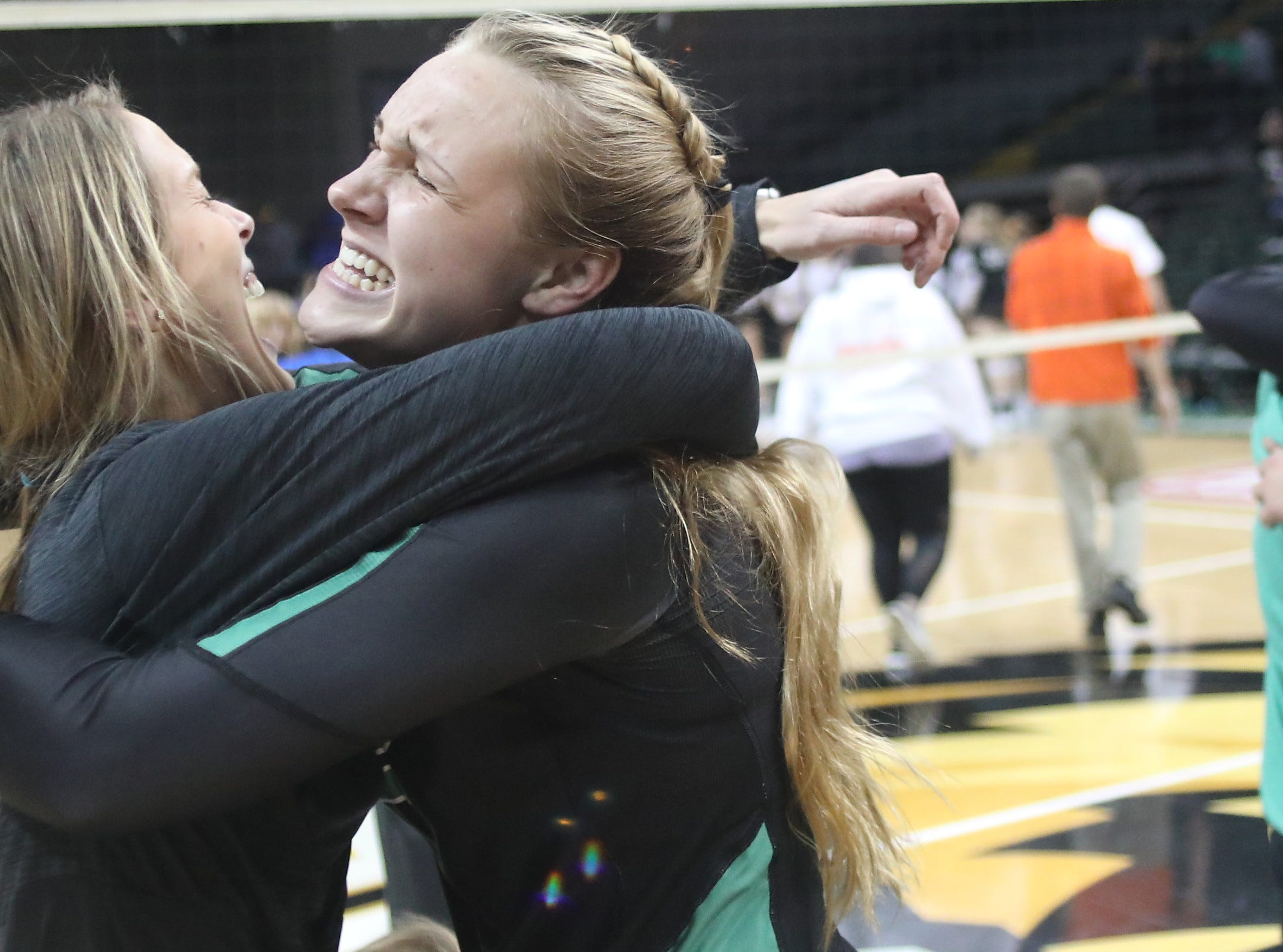 Ursuline Academy players celebrate after winning the Division I state volleyball championship Saturday, Nov. 10, 2018.