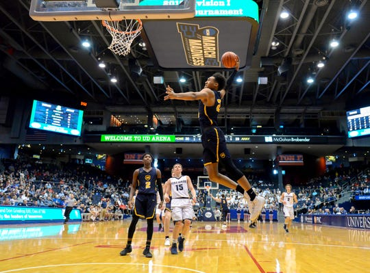 Jeremiah Davenport of Moeller flies through the air for a thunderous slam dunk against Fairmont in the OHSAA district final, UD Arena, Saturday March 10, 2018.