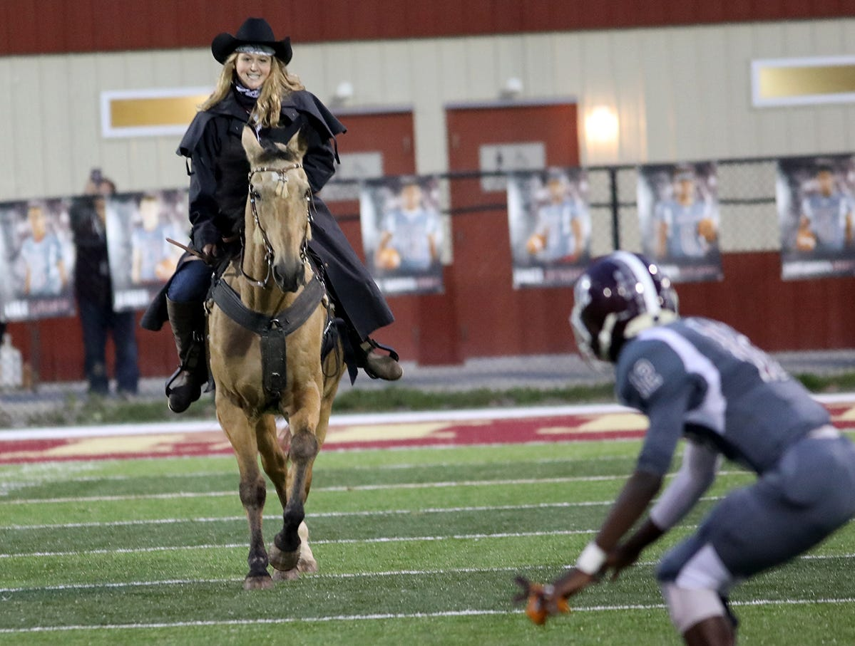 The Western Hills Mustangs get ready for their game against Taft  with a real horse on the field,  Friday, Oct. 12, 2018.