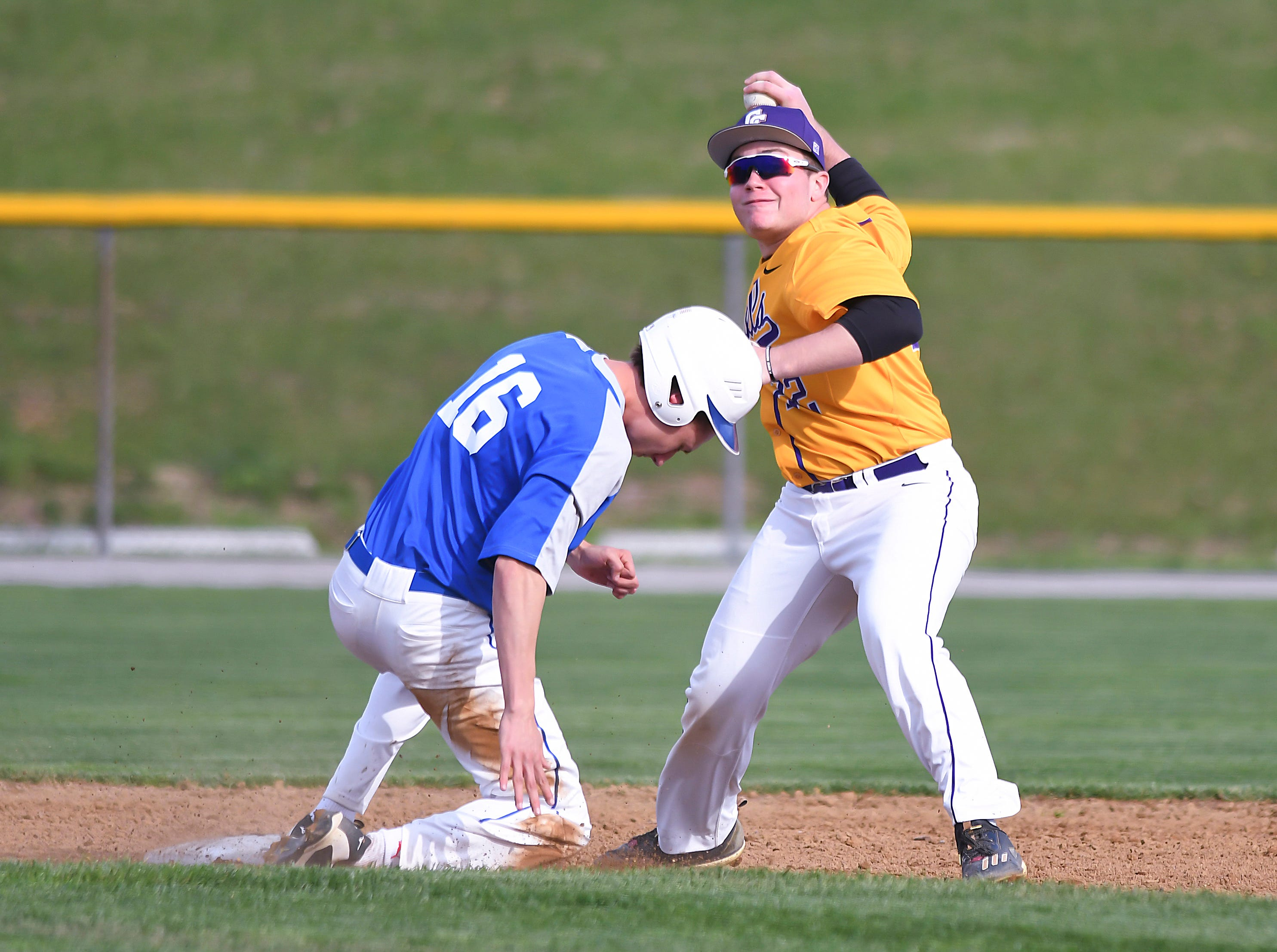 Brady Brooks (right) turns the double play against Highlands at Campbell County High School, April 26, 2018