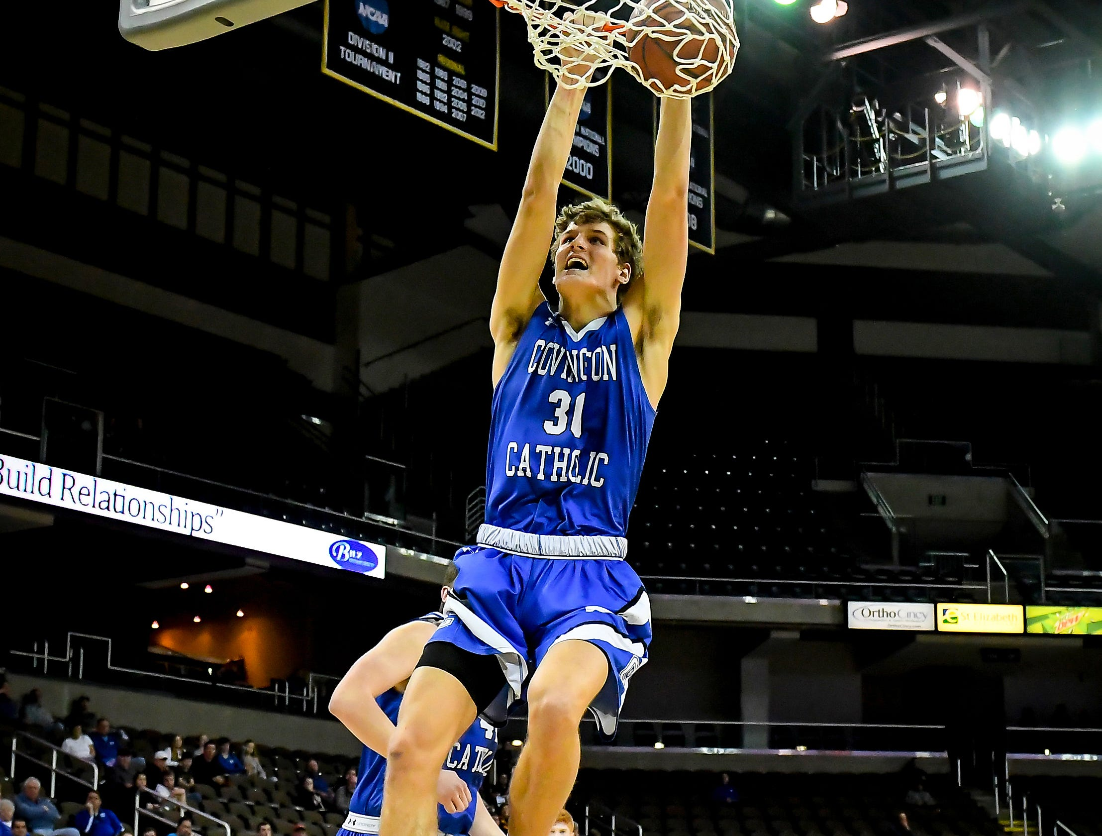 Nick Thelen of Covington Catholic goes in for the dunk against Cooper in the Bluegrass-Buckeye Charity Classic at BB&T Arena, Sunday, Jan. 21, 2018.