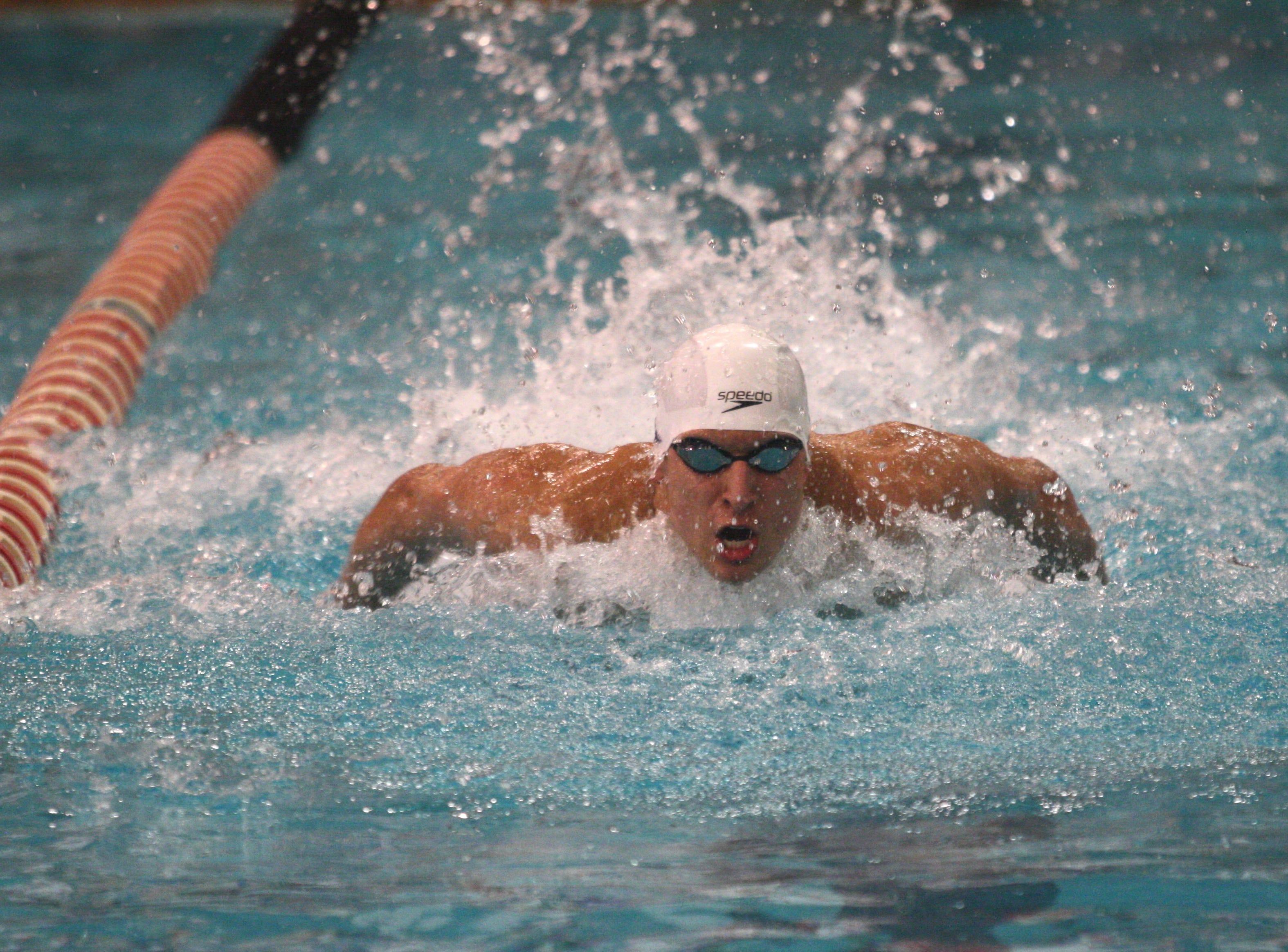 St. Xavier's Nicholas Perera competes in the 200 individual medley at the Division I state swim meet Saturday, Feb. 24, 2018, at C.T. Branin Natatorium.