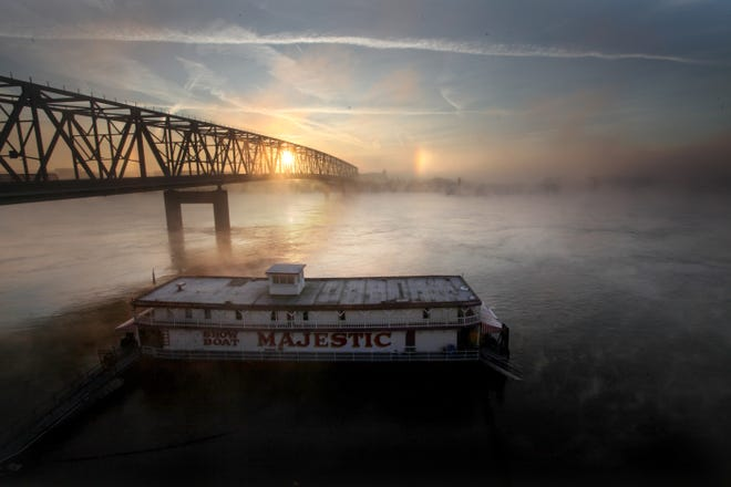 The Showboat Majestic is docked at the Public landing in 2011 as fog rolls off the Ohio River.