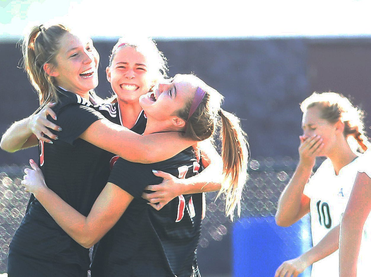 Indian Hill players celebrate after a goal in the first half of their regional final against Kettering Alter, Saturday, Nov. 3, 2018.