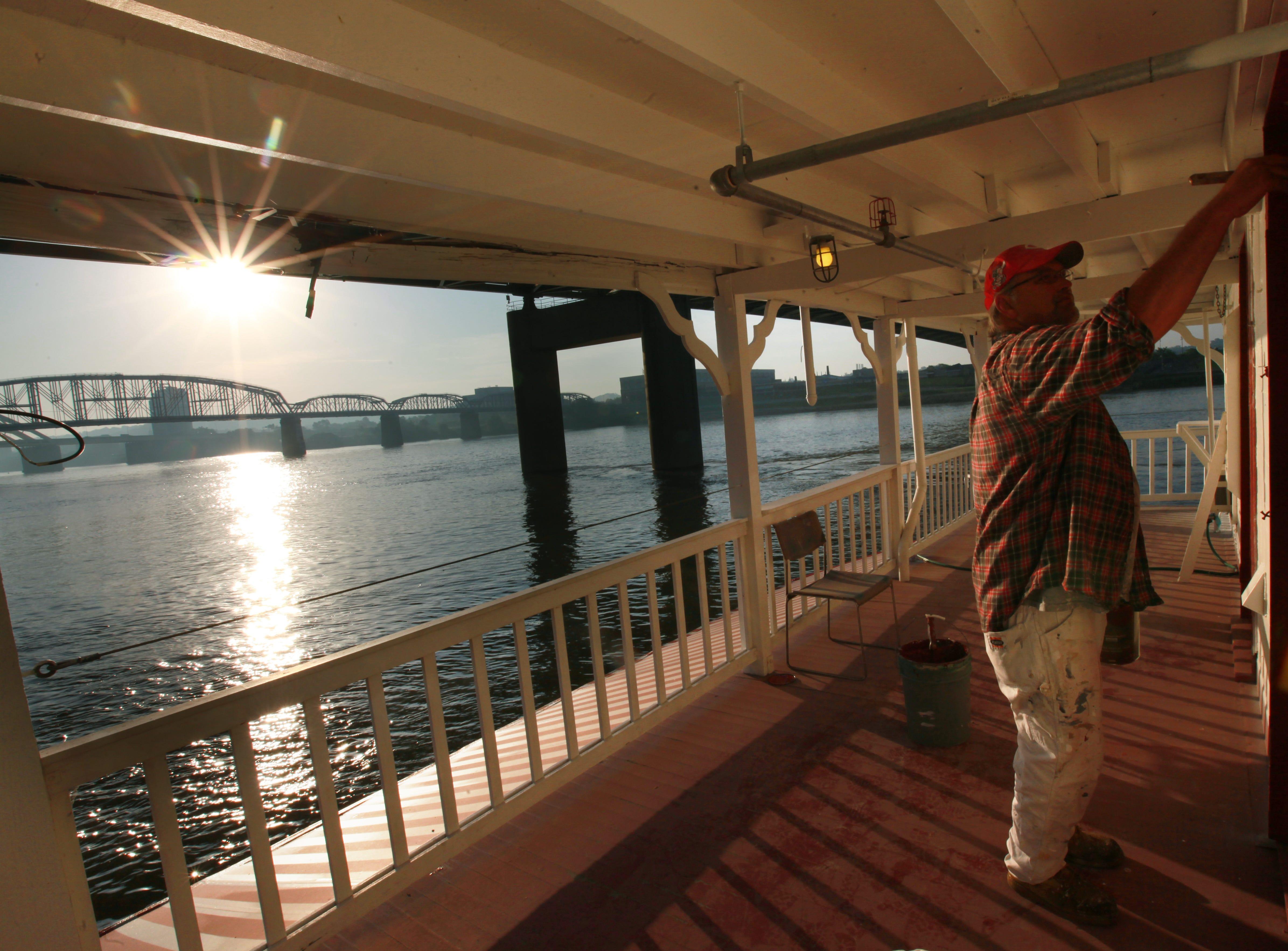 Ron Morgan of Unique Construction paints the Showboat Majestic in 2012.