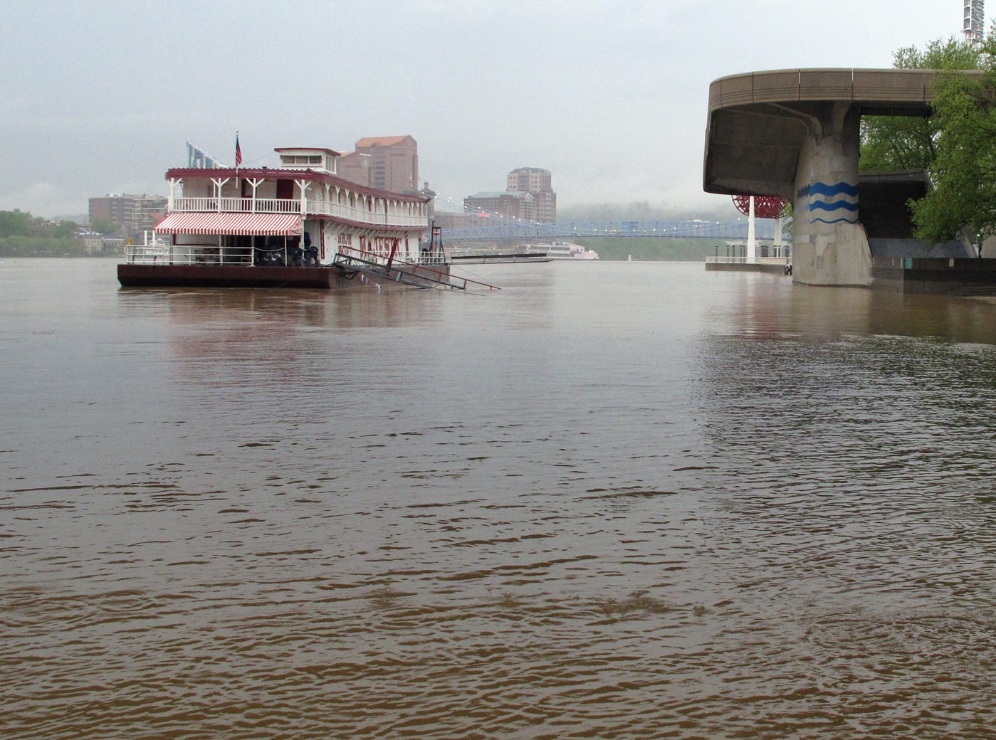 The Public Landing is totally covered by water and the Showboat Majestic moors close to the US Bank Arena steps in 2011.