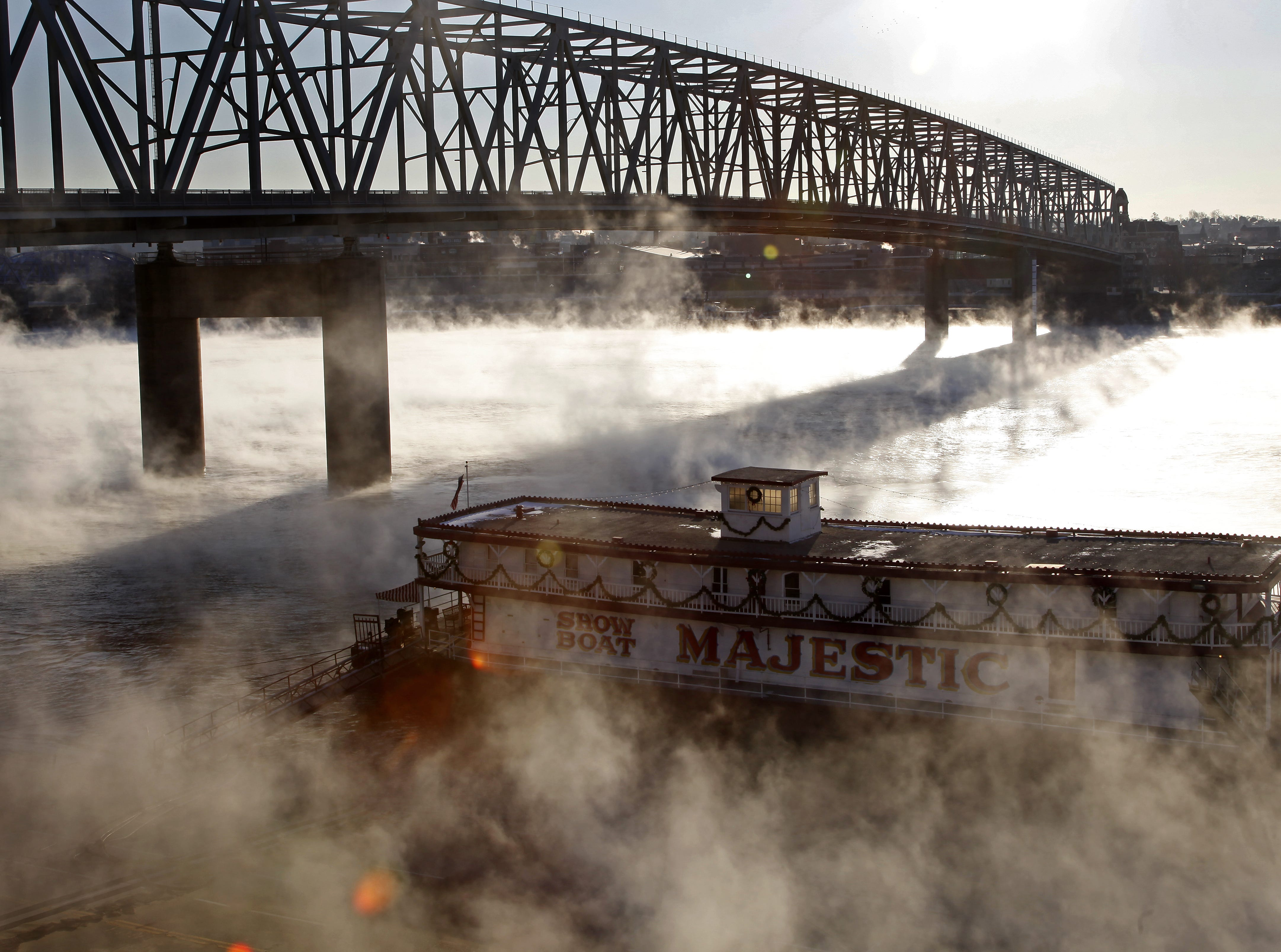 River Fog rises of the Ohio as the Showboat Majestic sits off the Public Landing in 2009.