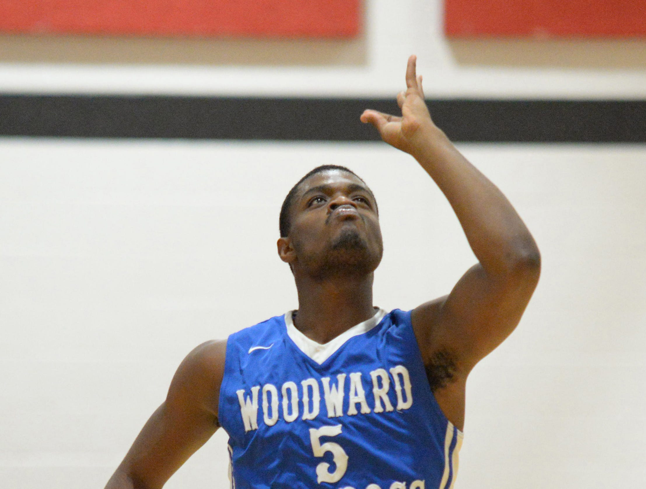 Woodward forward Terry Durham celebrates after making a three-pointer against Hughes at Hughes High School, Friday, Jan. 19, 2018.