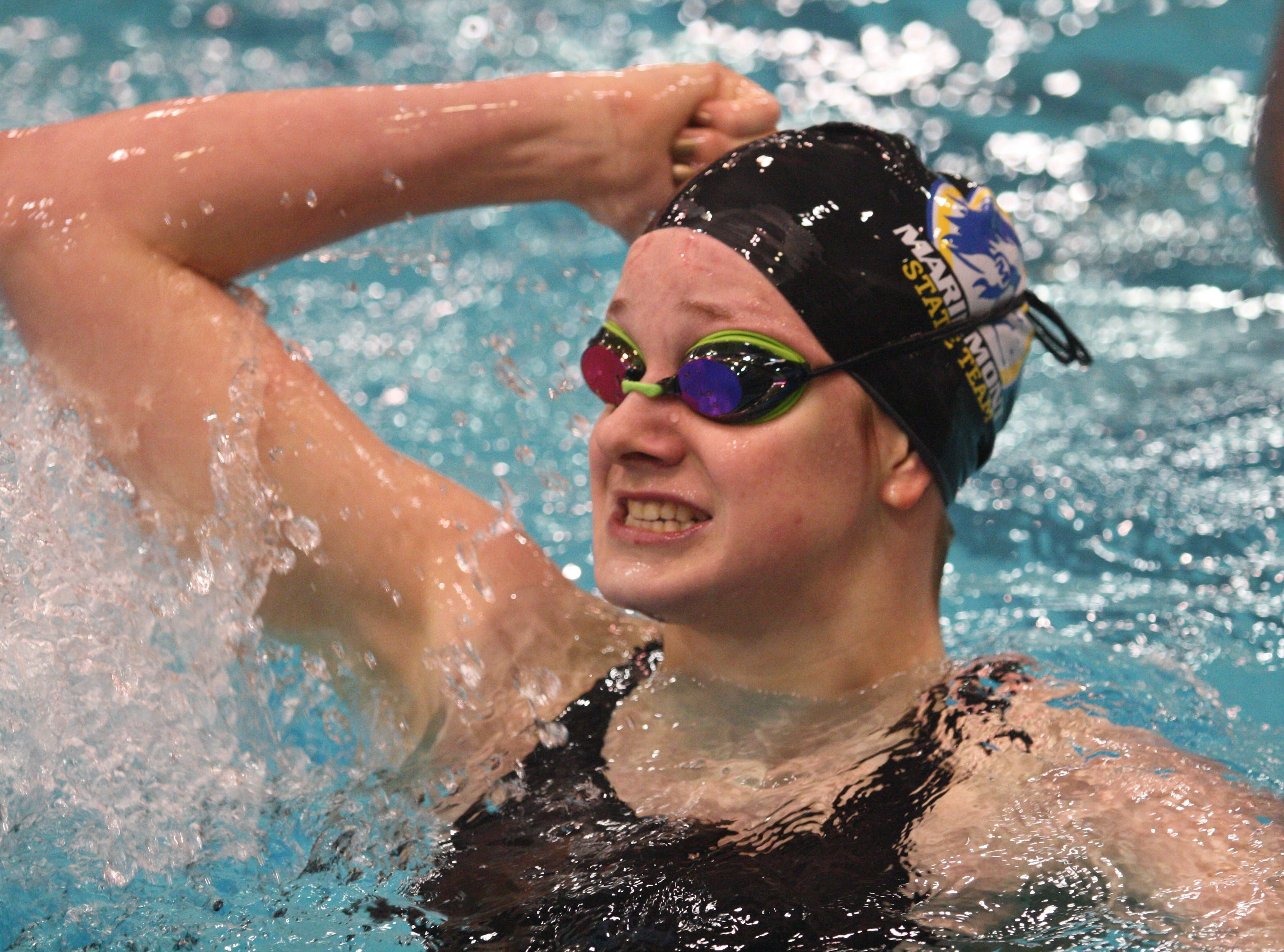 Mariemont junior Kate Overbey celebrates a fourth-place finish in the 200 individual medley at the Division II state championship on Friday, Feb. 23, 2018, at C.T. Branin Natatorium in Canton, Ohio.