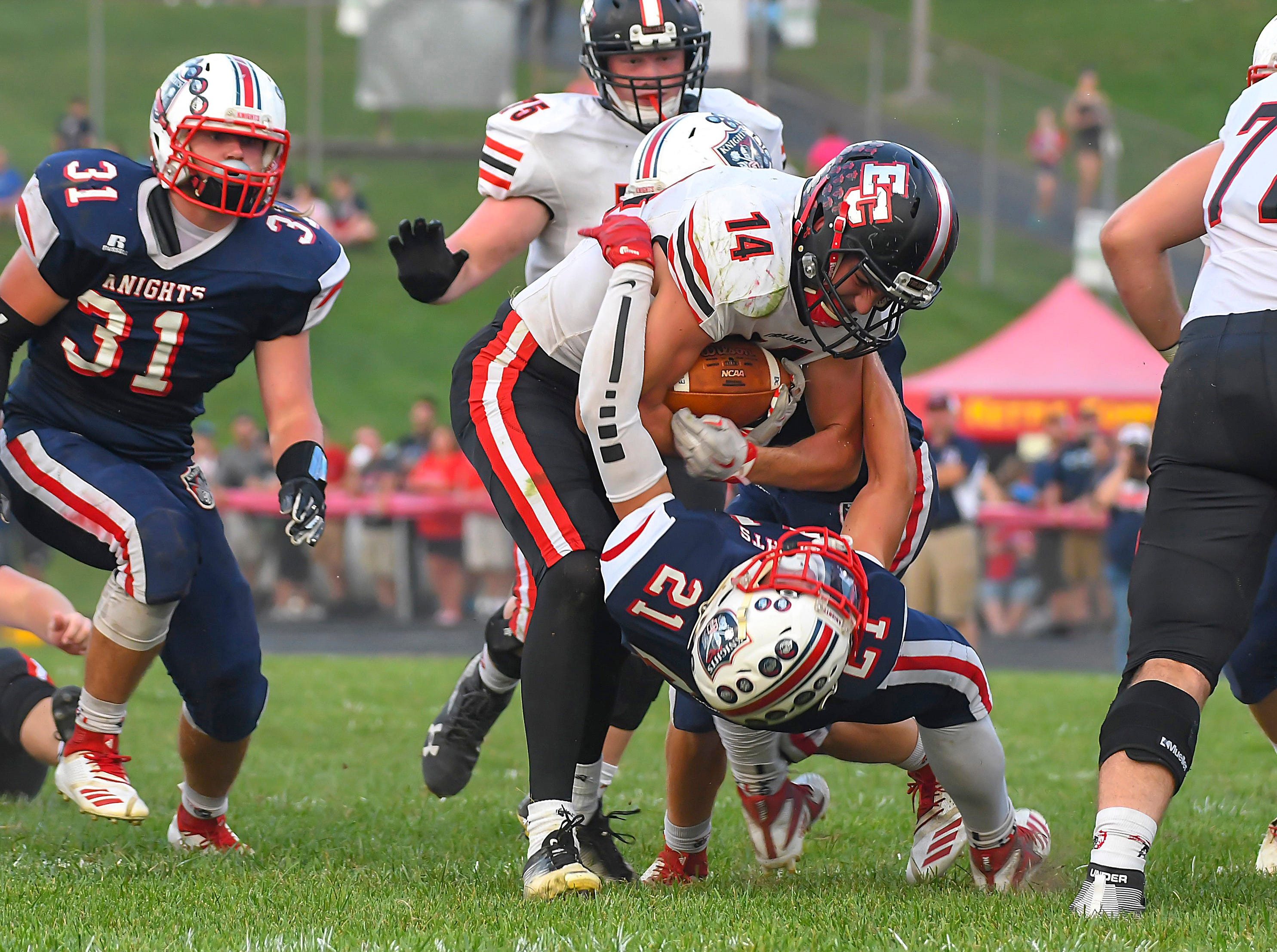 East Central running back Eric Rosemeyer (14) steamrolls a South Dearborn defender in the first quarter, South Dearborn High School, Aurora, Indiana, Friday September 21, 2018