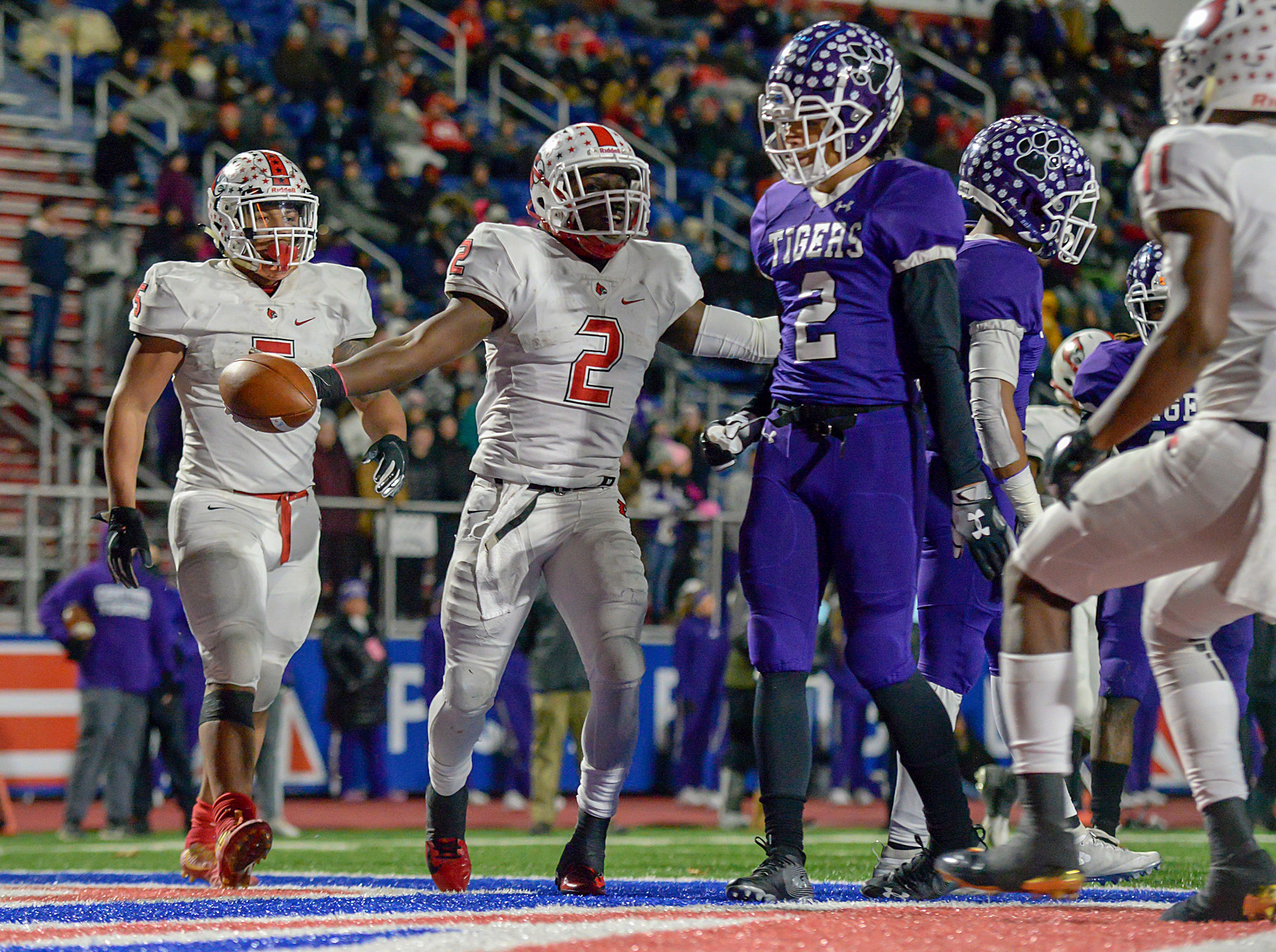 Colerain quarterback Deante Smith-Moore (2) celebrates after scoring a touchdown against Pickerington Central in the OHSAA Region IV D1 State Semi-Final at Piqua High School, Friday Nov. 23, 2018