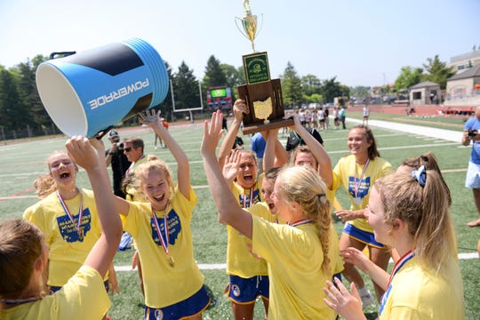 Mariemont players celebrate their win in the OHSAA Division II girls lacrosse state championship, Selby Stadium, Ohio Wesleyan University, Delaware, Ohio.