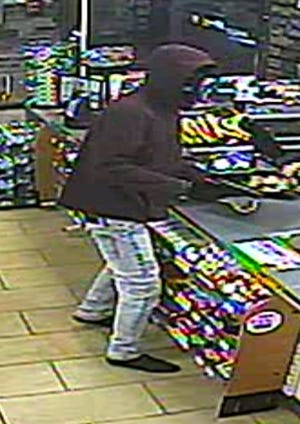 An image of a robbery suspect in West Babylon, New York, which police said is similar to a fatal robbery in Edison Township that occurred a day later.