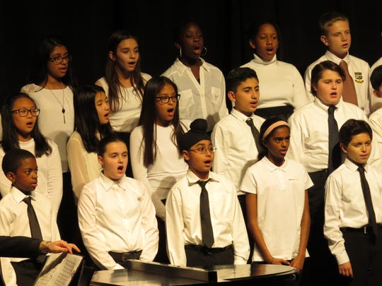 The sixth grade choir performs at the Middle School winter concert.